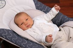 Newborn Baby Lying In Bouncer Chair Royalty Free Stock Photos