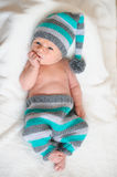 Newborn baby lying in a suit gnome Royalty Free Stock Photo