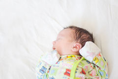 Newborn baby lying on a white diaper Royalty Free Stock Photo