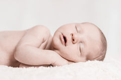 Newborn Baby Male Sleeping Peacefully Closeup Face. Newborn Baby Male Laying Down Sleeping Peacefully Closeup Face Royalty Free Stock Photography