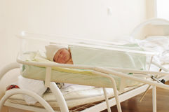 Newborn baby in maternity hospital Royalty Free Stock Image