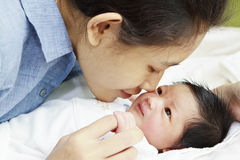 Newborn baby and mom. Asian newborn baby and mom royalty free stock image
