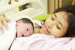 Newborn baby and mom Stock Image