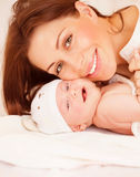 Newborn baby with mommy Stock Image