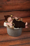Newborn Baby in a Monkey Costume Royalty Free Stock Image