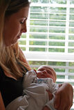 Newborn Baby with Mother. 12 day old baby sleeps in mother's arms Royalty Free Stock Image
