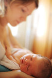 Newborn baby with mother Stock Photos