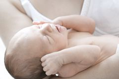 Newborn baby in mothers hand Royalty Free Stock Photo