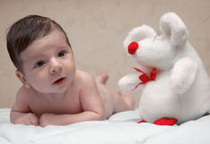 Newborn Baby and Mouse. With red nose Stock Photos
