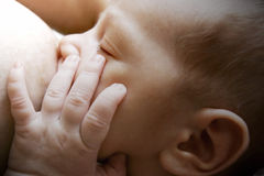 Newborn baby near breast Stock Images