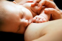 Newborn baby near breast Royalty Free Stock Photos