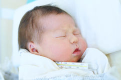 Newborn baby in one day life Royalty Free Stock Image