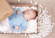 Newborn baby in open post box stock photos