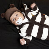 Newborn baby with pacifier stock photo