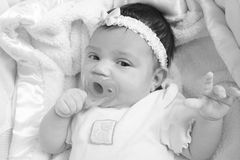 Newborn baby with a pacifier Royalty Free Stock Photos