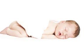 Newborn baby peacefully sleeping royalty free stock photography