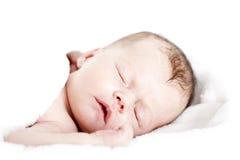 Newborn baby peacefully sleeping Stock Image