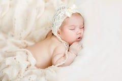 Newborn baby peacefully sleeping. Sleeping newborn baby boy on tummy Stock Images