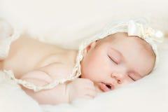 Newborn baby peacefully sleeping. Sleeping newborn baby boy on tummy Royalty Free Stock Photography