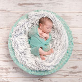 Newborn baby peacefully sleeping in round cot Royalty Free Stock Photography