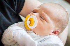Newborn Baby. A person holding a newborn baby stock photos