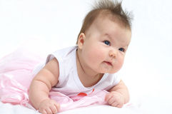 Newborn baby in pink dress Stock Images