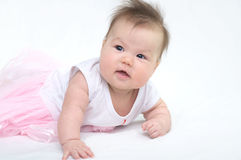 Newborn baby in pink dress smiling Stock Photos