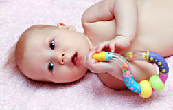 Newborn baby playing Royalty Free Stock Image