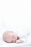 Newborn baby in pyjamas sleeping on white background isolated Royalty Free Stock Photography
