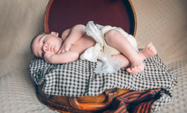 Newborn baby resting lying above of travel Stock Image