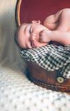 Newborn baby resting lying above of travel Stock Image