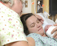 Newborn baby right after delivery Stock Images