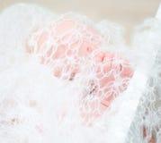 Newborn baby's legs Stock Photo