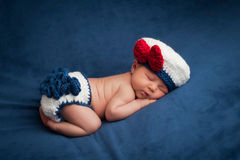 Newborn Baby in Sailor Girl Costume Stock Images