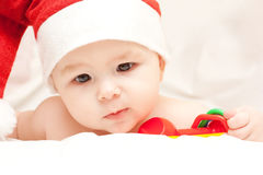 Newborn baby in Santa Claus hat Stock Photo