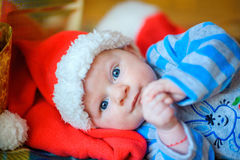 Newborn baby in Santa Claus`s cap Royalty Free Stock Photography