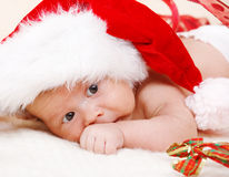 Newborn baby in Santa hat. Attractive newborn baby in Santa hat Royalty Free Stock Images