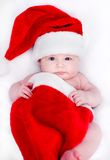 Newborn baby in a Santa hat Royalty Free Stock Images