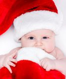 Newborn baby in a Santa hat Stock Photo