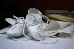 Newborn baby shoes. Elegant, white colored for christening Royalty Free Stock Photo