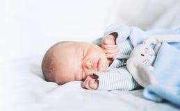 Newborn baby sleep first days of life at home. Newborn baby sleep first days of life. Cute little newborn child sleeping peacefully Stock Photo
