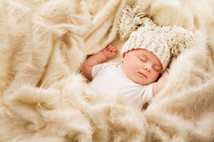 Newborn Baby Sleep in Hat, Sleeping New Born Kid, Asleep Child. Newborn Baby Sleep in Hat, Sleeping New Born Kid, Asleep Happy Child in Woolen Bed Royalty Free Stock Photo