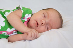 Newborn baby Sleeping. Against a White Background Royalty Free Stock Photography
