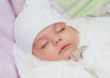 Newborn baby sleeping. Portrait of a sleeping newborn baby, girl, the child is lying in her back stock photography