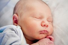 Newborn baby sleeping. Portrait of newborn baby sleeping Stock Photo