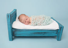 Newborn Baby Sleeping on Bed Stock Photo