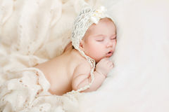 Newborn baby sleeping on a bed Royalty Free Stock Photography