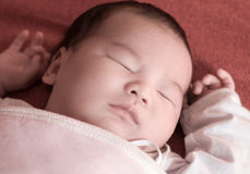 Newborn baby sleeping on the bed Royalty Free Stock Photography