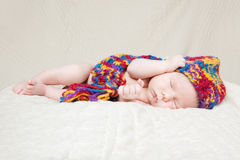 Newborn baby sleeping on a blanket Stock Images