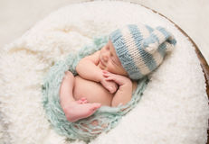 Newborn Baby Sleeping on Blanket Stock Images